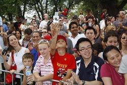 Fans watch the Ferrari street parade