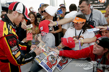 Kasey Kahne signs autographs for fans after qualifying on pole position