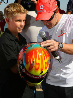 Fernando Alonso, McLaren Mercedes, meets young racing hopeful, Chris Hays - Vodafone and McLaren Mercedes event