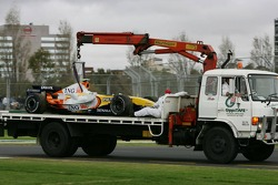 Heikki Kovalainen, Renault F1 Team, car returns to the pitlane on a truck