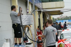BMS Scuderia Italia team members at work