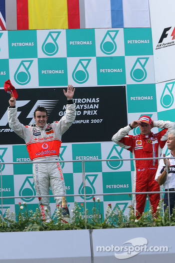 Podium: race winner Fernando Alonso with Kimi Raikkonen