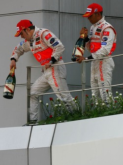 Podium: race winner Fernando Alonso with Lewis Hamilton