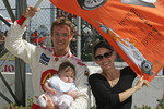Pole winner Sébastien Bourdais celebrates with wife Claire and daughter Emma