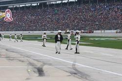 NASCAR officials clean up pit road