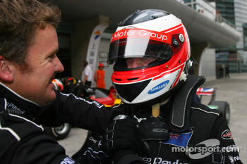 Jonny Reid, Driver of A1Team New Zealand  is congratulated by the team