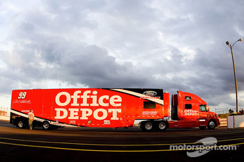 The Office Depot Ford team hauler enters the track