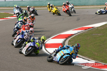 Start: John Hopkins leads Valentino Rossi