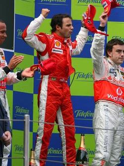 Podium: race winner Felipe Massa with Lewis Hamilton and Fernando Alonso