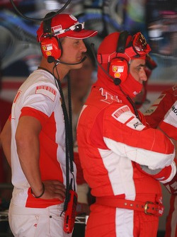 Michael Schumacher, Scuderia Ferrari, Advisor views the race from the Ferrari garage