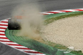 Fernando Alonso, McLaren Mercedes, MP4-22, kicks up some dirt