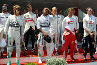 (L to R): Nico Rosberg, Mercedes AMG F1; Lewis Hamilton, Mercedes AMG F1; Sebastian Vettel, Ferrari; Daniil Kvyat, Red Bull Racing, as the grid observes the national anthem