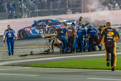 Crews tend to the wrecked car of Austin Dillon, Richard Childress Racing Chevrolet