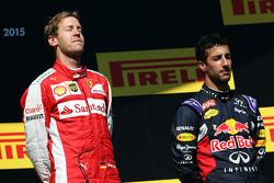 Race winner Sebastian Vettel, Ferrari celebrates on the podium with Daniel Ricciardo, Red Bull Racing