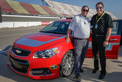General Motors Executive Vice President of Product Development Mark Reuss with NASCAR official Buster Auten and the Chevrolet SS pace car