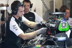 McLaren mechanics work on the McLaren MP4-30 of Fernando Alonso,