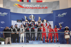 LMGTE Am podium: winners Andrea Bertolini, Viktor Shaitar, Alexey Basov, SMP Racing, second place Christian Ried, Earl Bamber, Khaled Al Qubaisi, Proton Competition, third place Emmanuel Collard, Rui Aguas, François Perrodo, AF Corse