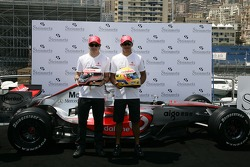 Lewis Hamilton, McLaren Mercedes and Fernando Alonso, McLaren Mercedes, with Steinmetz Diamonds in their helmets