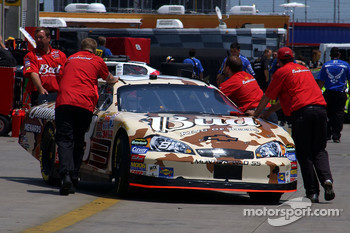 Dale Earnhardt Jr.'s car is pushed through the garage area
