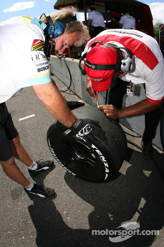 Bridgestone technician takes tire temperature