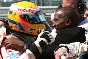 Pole Position, 1st, Lewis Hamilton, McLaren Mercedes, MP4-22, celebrates with his father, Anthony Hamilton