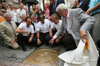 The winners of the 24 Hours of Le Mans 2006 Marco Werner, Frank Biela and Emanuele Pirro unveil the traditional winners manhole cover in downtown Le Mans