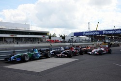 Wrecked cars in the parc fermé