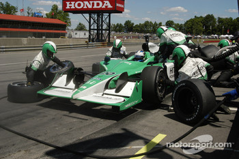 A pit stop for Ed Carpenter tires off