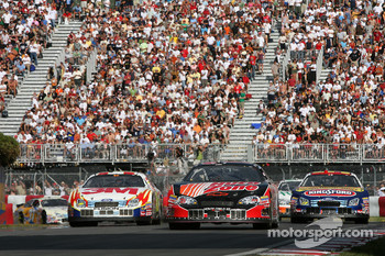 Kevin Harvick leads Todd Kluever and Marcos Ambrose