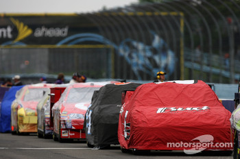 Cars under cover as the rain falls