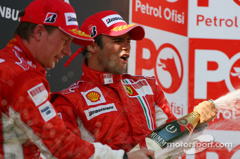 Podium: champagne for Kimi Raikkonen and Felipe Massa