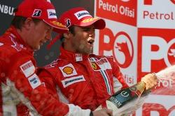Podium: champagne for Kimi Raikkonen and Felipe Massa