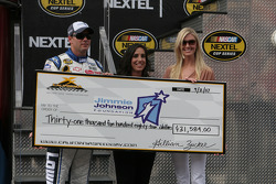 Jimmie Johnson receives a check for the Jimmie Johnson Foundation