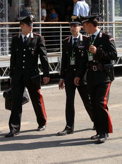 Carabinieri police officer outside McLaren Mercedes