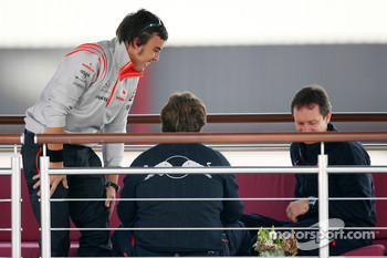 Fernando Alonso, McLaren Mercedes has a talk with Christian Horner, Red Bull Racing, Sporting Director