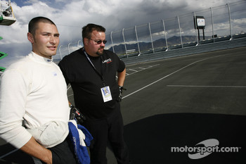 Nick Wittmer looks at the damaged #31 i-MOTO Racing Acura TSX