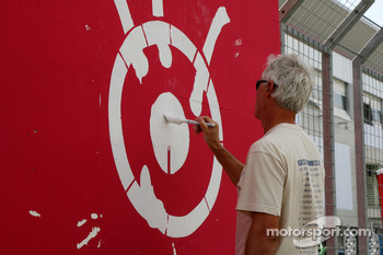The final touches are put to the circuit, Painting the track advertising