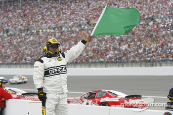 A Nextel Cup official signals that pit road is open for business