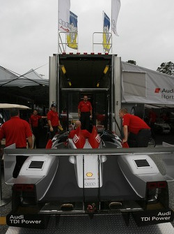 Audi Sport North America team members put the Audi R10 TDI Power back in the transporter