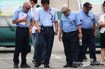 Charlie Whiting, FIA Safty delegate, Race director & offical starter and Herbie Blash, FIA Observer inspect the circuit