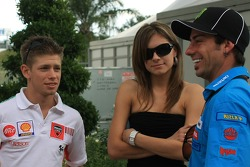 Casey Stoner and his wife, Adriana talks with John Hopkins