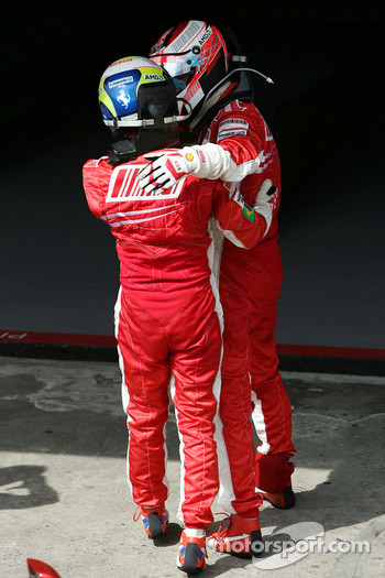 Race winner and 2007 World Champion Kimi Raikkonen celebrates with Felipe Massa