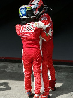 Race winner and 2007 World Champion Kimi Raikkonen celebrates with Felipe Massa