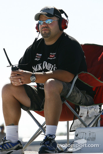 A Clint Bowyer fan watches the #07 circle the track