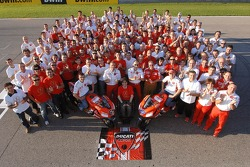 Ducati Marlboro group shot: Casey Stoner and Loris Capirossi pose with Ducati Marlboro team members