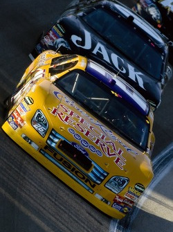 Jamie McMurray leads Clint Bowyer
