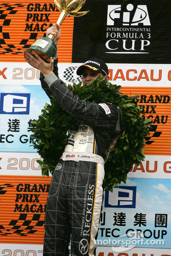 Podium: race winner Oliver Jarvis celebrates