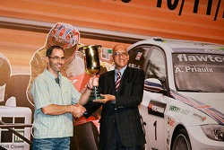 Alain Menu collects the winner's trophy