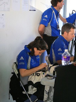 Michele Quaife sewing patches on (a Team Manager's work is never done)