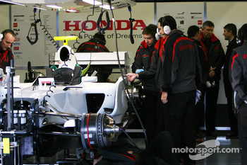 Ross Brawn Team Principle, Honda Racing F1 Team and Nick Fry, Honda Racing F1 Team, Chief Executive Officer watch at the back of the garage